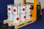 stock photo of pallet  - Industrial bucket cans with flammable material at forklift pallet