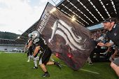 INNSBRUCK, AUSTRIA - JUNE 16 RB Lukas Miribung (#22 Raiders) leads his team on the football field on