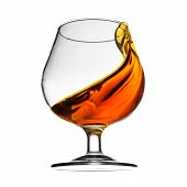 Splash of cognac in glass on white background
