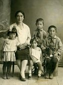 stock photo of debonair  - Retro portrait of a Family Caucasus Russia - JPG