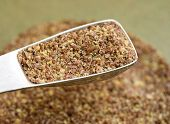stock photo of tablespoon  - Ground flax seeds in metal tablespoon for nutrition - JPG