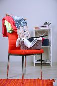 picture of slut  - Heap of  clothes on color chair - JPG