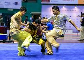 KUALA LUMPUR - NOV 05: Members of Egyptian dalian team performs a fight scene in the Men's Dual Event at the 12th World Wushu Championship on November 05, 2013 in Kuala Lumpur, Malaysia.