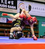 KUALA LUMPUR - NOV 03: Turkey's Ismail Uznuner (red) fights Daniel Madeira in the Men's 'Sanda' even