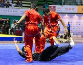 KUALA LUMPUR - NOV 05: Members of India's dalian team performs a fight scene in the Men's Dual Event at the 12th World Wushu Championship on November 05, 2013 in Kuala Lumpur, Malaysia.