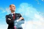 Image of confident businessman smiling standing against hightech background
