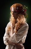 girl with mountain ash berries wreath