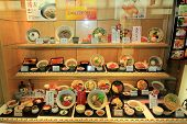 Plastic Food Models In The Window Of A Japanese Restaurant.