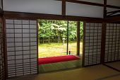 Japanese Garden With Stone Garden Seen Through The Sliding Doors Of A Temple In Kyoto, Japan