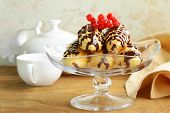choux pastry eclairs on glass stand base, festive dessert