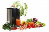 A Juicer surrounded by healthy vegetables and fruit, isolated on white.