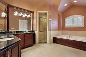Master bathroom in luxury home with salmon colored walls