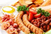 Fried Eggs With Sausages And Subfried Bread