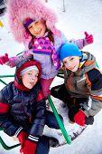 Happy kids in winterwear having fun outside