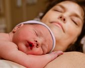 Mother and infant child resting after delivery at hospital