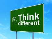 Education concept: Think Different and Head With Lightbulb on road sign background