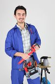 stock photo of blow torch  - Man stood with wrench and blow torch - JPG