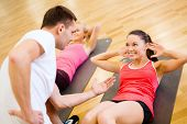 fitness, sport, training, gym and lifestyle concept - group of smiling women with male trainer doing