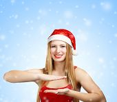 Woman In Santa Claus Hat Holding Something In Hands