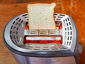 Fresh Slice Of Bread On Hot Metal Toaster
