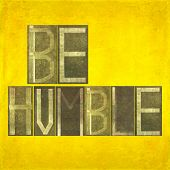 picture of humility  - Earthy textured background image and design element depicting the words  - JPG