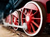 stock photo of locomotive  - retro steam locomotive red wheels close up - JPG