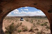 Cave View Of Car And Desert