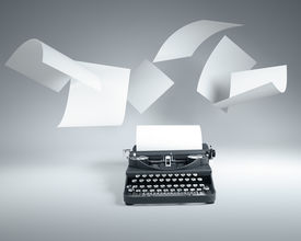 stock photo of outdated  - old type writer with paper sheets flying - JPG