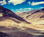 Vintage retro effect filtered hipster style travel image of Himalayan valley landscape with road nea