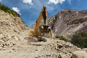 stock photo of jammu kashmir  - Excavator doing road construction in Himalayas - JPG