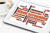blood screening healthcare concept - word cloud on a digital tablet with cup of coffee
