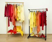 Shades of yellow, orange and red clothes.