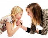 Mother and daughter in playful arm wrestle