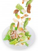Caesar salad with chicken and greens.