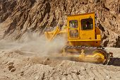 stock photo of jammu kashmir  - Bulldozer doing road construction in Himalayas - JPG