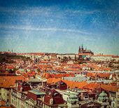 Vintage retro hipster style travel image of Stare Mesto (Old City) and and St. Vitus Cathedral from Town Hall. Prague, Czech Republic with grunge texture overlaid