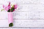 Beautiful wedding bouquet on wooden background