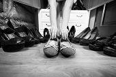 Woman Holding Ballet Flats Rather Then High Heels