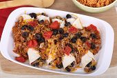 pic of enchiladas  - Beef and been enchiladas with black olives and rice on a baking dish - JPG