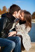 Romantic Couple Kissing In Autumn Park