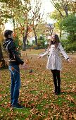 Happy Young Couple Playing With Leaves At Fall