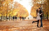 stock photo of sweethearts  - Young beautiful couple in the Luxembourg garden at fall - JPG