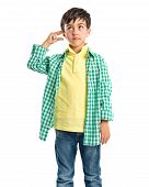 picture of lunate  - Kid making a crazy gesture over white background - JPG