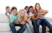 Teenagers Playing Video Games At Home poster