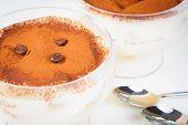 Italian Tiramisu Dessert Served In A Cup Near Spoons