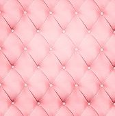 Abstract background texture of an old natural luxury, modern style leather with rhombs. Classic white, red and light pink grungy skin of retro wall, door, sofa or studio interior with metal buttons.