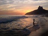 stock photo of ipanema  - Woman in sea on beach ipanema Leblon sunset Rio de Janeiro - JPG