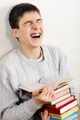 Cheerful Teenager With A Books