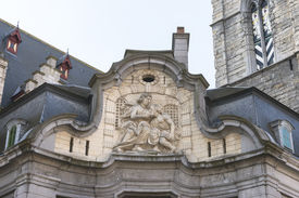 stock photo of lactating  - Antique fresco of the Mammelokker at side of Belfry in Ghent - JPG