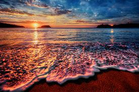 image of inlet  - Warm morning on a sandy beach in an ocean bay  - JPG